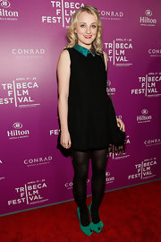 Evanna Lynch's little black dress had a pop of color on the collar, which the star enhanced even more by pairing it with matching shoes.
