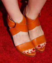 Lily Rabe chose these orange strappy sandals to brighten up her red carpet look at the 2013 Tribeca Film Festival LA Reception.