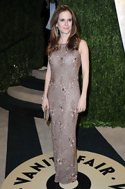 Kelly Preston showed off her classic style at the Vanity Fair Oscar party with a brown sequin-embellished gown.