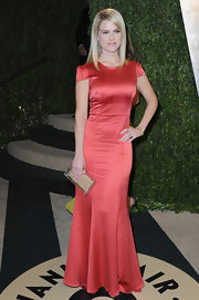 Alice Eve opted for a figure-flattering capped sleeve, satin gown for her look at the Vanity Fair Oscar party.