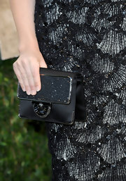 Jennifer Westfeldt's embellished black satin clutch at the 2013 Vanity Fair Oscar party had an Art Deco feel.