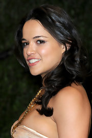 Michelle Rodriguez sported big bouncy waves when she attended the 2013 Vanity Fair Oscar party.