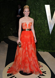 Elizabeth Banks showed off her quirky style with this vibrant strapless orange gown with a deep neckline and stylish belt.