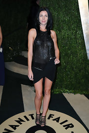 Liberty Ross showed some skin at the Vanity Fair Oscar party in a black see-through, lycra mini dress.