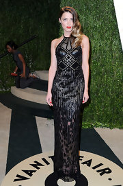 Amber Heard showed her edgy side at the Vanity Fair Oscar party with this semi-see-through black halter gown.