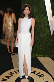 Rose Byrn kept her look sleek and stylish at the Vanity Fair Oscar Party with this white gown with front slit.