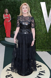 Arianna Huffington opted for an edgy but feminine look at the Vanity Fair Oscar Party with this black lace gown.