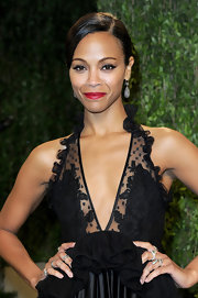 After the 2013 Oscars, Zoe Saldana swapped her barely there lip color for a ravishing red hue.