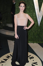 Jessica Lowndes opted for a two-toned column-style gown for her evening look at the Vanity Fair Oscar party.