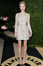 Kate Bosworth opted for a sweet and flirty look at the Vanity Fair Oscar party with this floral embroidered cocktail dress.