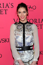 Hilary Rhoda teamed a bondage-chic leather belt with a demure floral dress for the Victoria's Secret fashion show after-party.