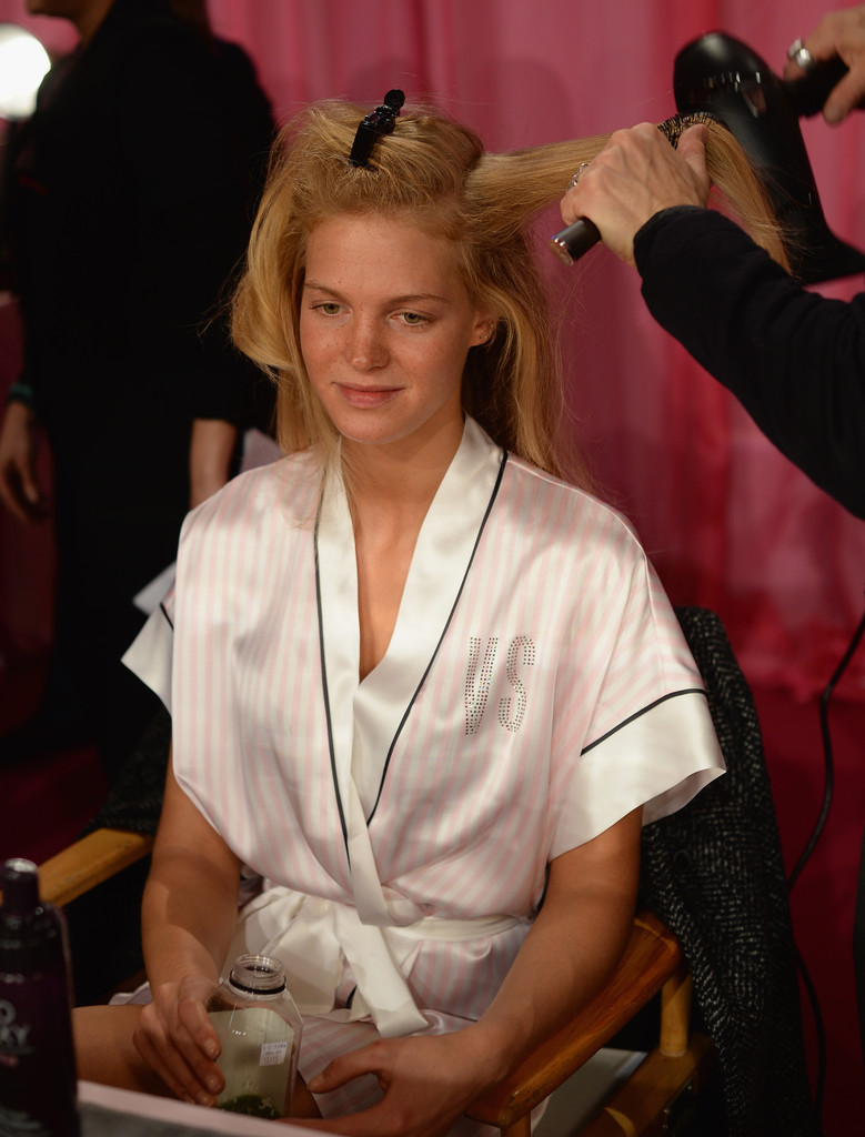 Model Erin Heatherton prepares at the 2013 Victoria's Secret Fashion Show hair and make-up room at Lexington Avenue Armory on November 13, 2013 in New York City.