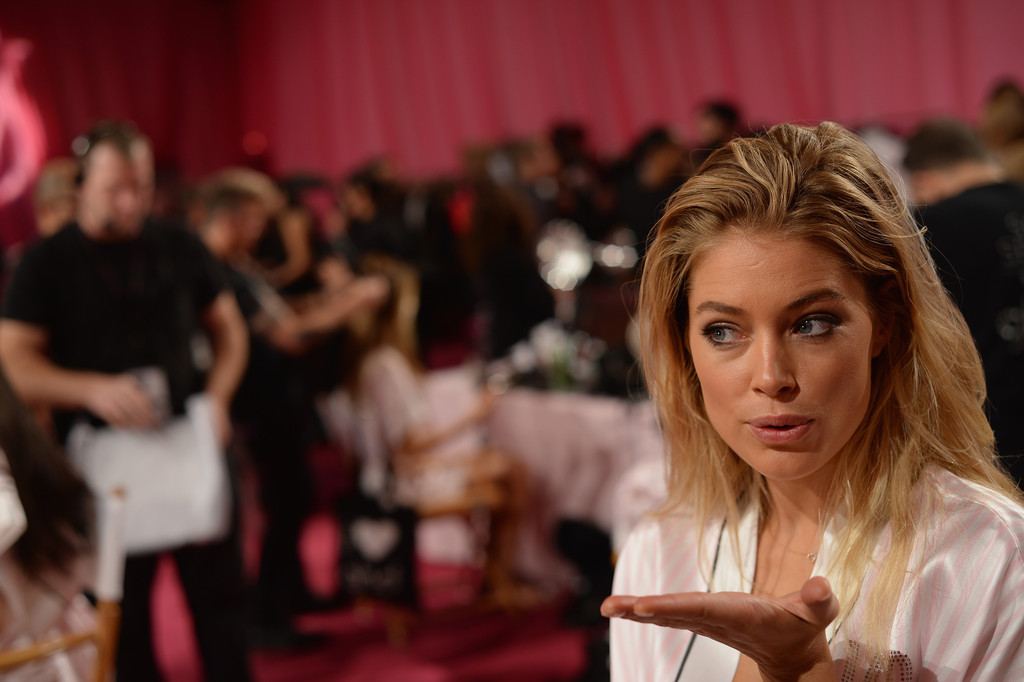 Model Doutzen Kroes prepares backstage at the 2013 Victoria's Secret Fashion Show at Lexington Avenue Armory on November 13, 2013 in New York City.