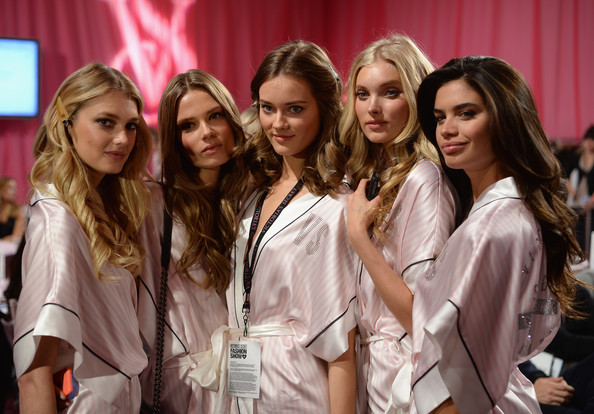 (L-R) Models Martha Hunt, Caroline Brasch, Monika Jagaciak, Elsa Hosk, and Sara Sampaio prepare at the 2013 Victoria's Secret Fashion Show hair and make-up room at Lexington Avenue Armory on November 13, 2013 in New York City.