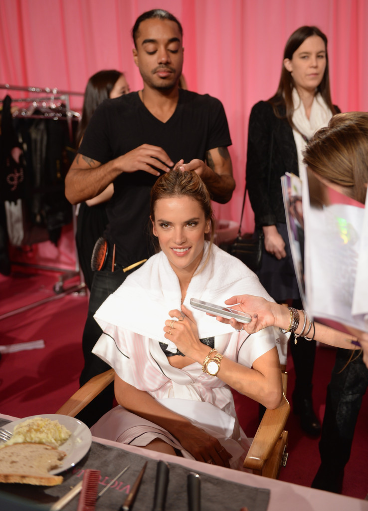 A model prepares at the 2013 Victoria's Secret Fashion Show hair and make-up room at Lexington Avenue Armory on November 13, 2013 in New York City.