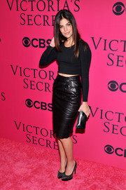 Julia Restoin-Roitfeld's black leather pencil skirt and crop-top were a fiercely stylish pairing.
