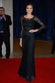 Irina Shayk chose a fitted lace gown with sheer long sleeves for her classy look at the White House Correspondents' Association Dinner.