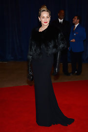 Sharon Stone chose a classic and sophisticated red carpet look at the White House Correspondents' Association Dinner where she wore this black gown and matching fur cape.