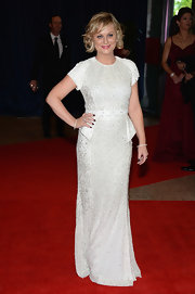 Amy chose this beaded white gown that features capped sleeves and a peplum waist.