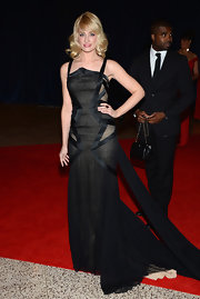 Beth Behrs chose this floor-length, strappy gown with a full train for her evening look.