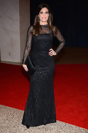 Kimberly Guilfoyle chose this black gown with sheer sleeves and glitter detailing for her red carpet look.