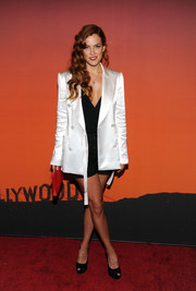 Riley Keough covered up with a super-chic white Louis Vuitton coat for the Whitney Gala and Studio party.