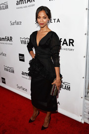 Zoe Saldana was all dolled up in a Marni LBD with a ruffled peplum waist during the amfAR Inspiration Gala.