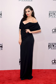 Charli XCX was all about classic glamour in a draped black off-the-shoulder gown by Vivienne Westwood Red Label at the American Music Awards.