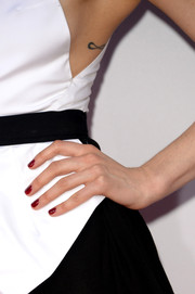 Taylor Schilling gave her monochrome dress a pop of color via her red nail polish.