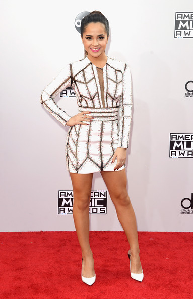 Becky G sported an ultra-modern long-sleeve white Nicolas Jebran mini dress with black sheer-panels during the American Music Awards.