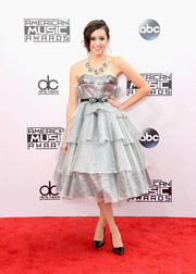 Megan Nicole got all dolled up in a tiered silver strapless dress for the American Music Awards.