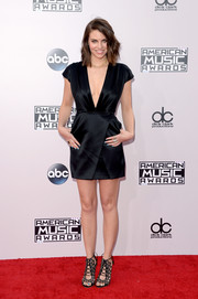 Lauren Cohan styled her dress with a pair of embellished black gladiator heels by Sophia Webster.