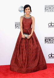 Jhene Aiko brought a dose of fairy-tale glamour to the American Music Awards red carpet with this wine-colored Alice + Olivia brocade gown.