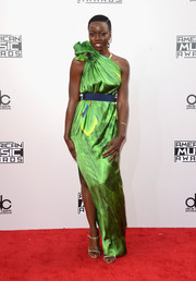 Danai Gurira chose a pair of gold slim-strap sandals to complete her sophisticated look.
