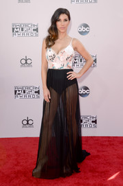 Adrianna Costa exposed her black undies and toned legs in a floral-bodice, sheer-skirt gown during the American Music Awards.