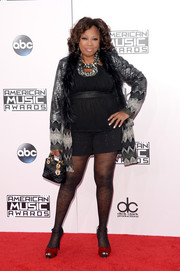 Star Jones injected some color via a pair of knotted red platform sandals.