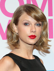 Taylor Swift styled her short locks with pretty waves and side-swept bangs for the Billboard Women in Music luncheon.