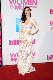 Charli XCX made lots of eyes pop with this see-through lace gown by Betsey Johnson at the Billboard Women in Music luncheon.