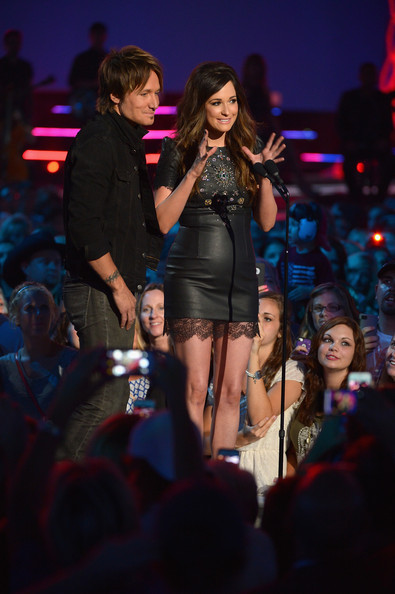 More Pics of Kacey Musgraves Leather Dress (2 of 18) - Kacey Musgraves Lookbook - StyleBistro [performance,entertainment,event,performing arts,music artist,public event,fashion,stage,thigh,singing,kacey musgraves,r,keith urban,award,nashville,tennessee,bridgestone arena,cmt music awards,show]