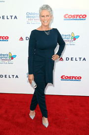 Jamie Lee Curtis paired her jumpsuit with glamorous silver evening pumps.