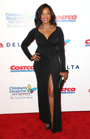 Garcelle Beauvais heated up the CHLA gala red carpet in a curve-hugging black gown with a wrap bodice and a thigh-high slit.
