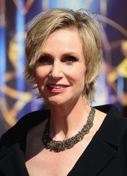 Jane Lynch added lots of sparkle to her look with a beautiful diamond statement necklace when she attended the Creative Arts Emmy Awards.