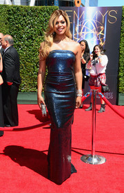 Laverne Cox glammed it up in a blue sequin strapless gown by Donna Karan at the Creative Arts Emmy Awards.