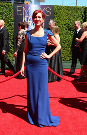 Carrie Preston went for classic glamour at the Creative Arts Emmy Awards in a blue gown with a beaded belt and cap sleeves.