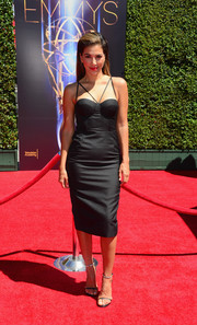 Liz Hernandez went for a bondage feel in a black corset dress by Misha Collection during the Creative Arts Emmy Awards.