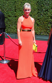 Karen Moyer was all about modern glamour in a sleeveless coral gown with a metal belt during the Creative Arts Emmy Awards.