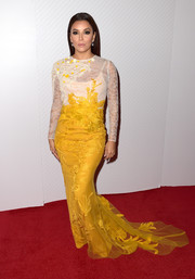 Eva Longoria brought a striking pop of color to the Global Gift Gala red carpet with this bright mustard and white lace gown by Ali Younes.