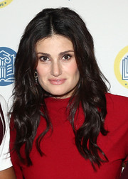Idina Menzel wore her lush locks down with a center part and boho waves during the (Em)Power breakfast.