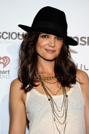 Katie Holmes topped off her look with a black fedora.