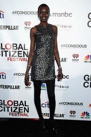 Alek Wek looked svelte in her silver and black mini dress during the Global Citizen Festival.